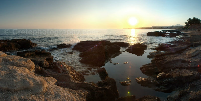 Sunrise over the Cretan Sea and rocks